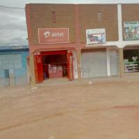 Shops and an incomplete building for sale at Luzira
