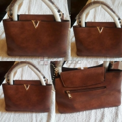 Ladies hand bag in brown color